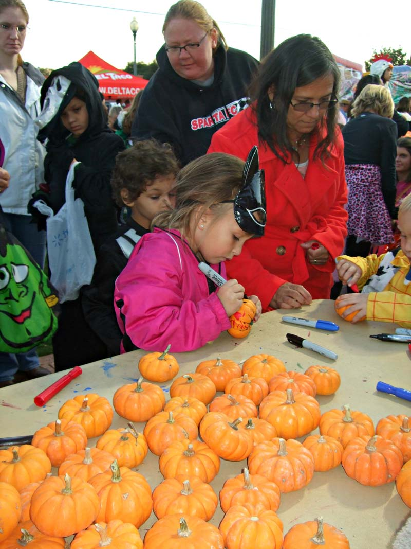 photo of kids and pumpkins